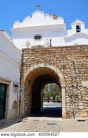 Faro, Portugal - June 12, 2017 - View Of The Rear Of The 19th Century City Gateway (arco Da Vila) In