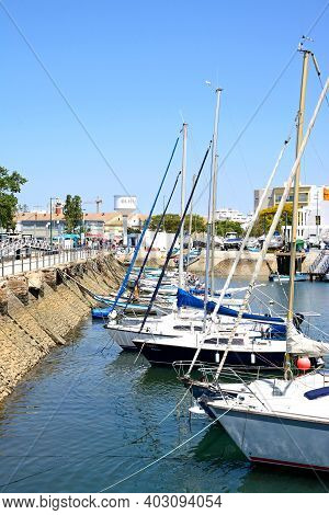 Olhau, Portugal - June 12, 2017 - View Of Yachts Moored In The Marina Against The Avenida 5 De Outub