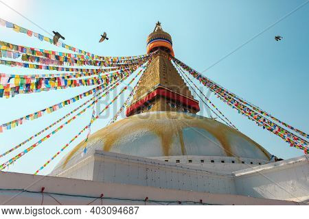 Multicolor Prayer Buddhist Flags Fluttering In The Wind On The Boudhanath Stupa In Kathmandu, Nepal.