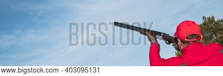 Shoots Skeet On A Trench Stand With A Shotgun Man Skeet Shooting Outdoors; Shooting Clay Pigeon Targ