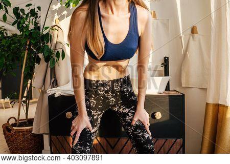 Yoga Concept. Portrait Of Unrecognizable Woman Doing Abdominal Vacuum And Practicing Upward Abdomina