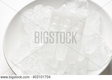 Vaccine Storage Fridge. Vials On The Ice. Long-term Storage Of Covid-19 Vaccine. Coronavirus Vaccine