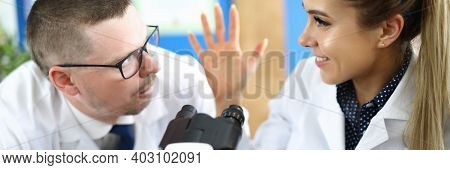 Portrait Of Woman Speaking With Colleague About Results Of Experiment. Man With Surprised Face. Tube