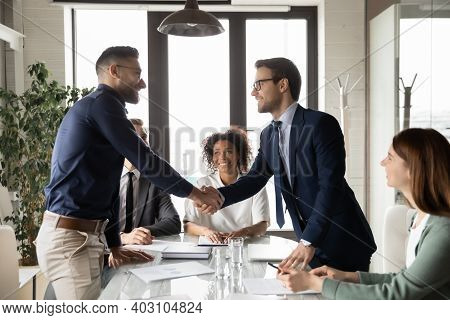 Happy International Businessmen Handshake At Office Business Meeting