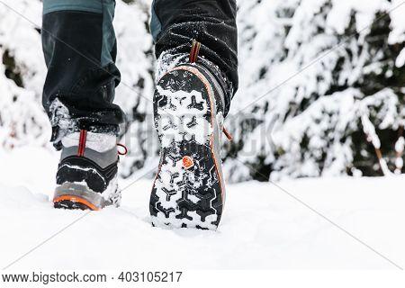 Hiking Boot Closeup, Winter Walking In Snow.