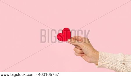 Beauty Woman Hands Holding Red Heart On Pink Background, Close-up. Pastel Colors, Copy Space For Tex