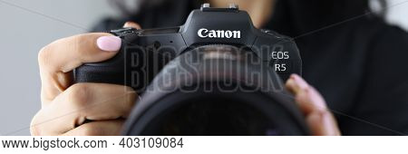 Minsk, Belarus - 30 July 2020 : Woman Hold New Model Canon Eos R5 Camera In Hand Closeup. Illustrati