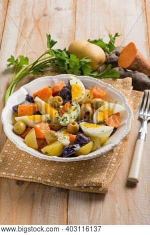 mixed salad with egg purple potatoes and olives