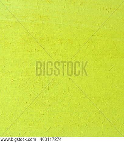 Close-up Surface Of Plywood Painted Yellow ,    Surface Of An Untreated Rough Wooden Board