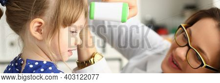 Cheerful Child Is Visiting Friendly Female Pediatrician For Measuring Temperature With Digital Therm
