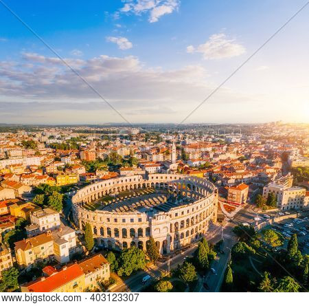 Exotic view at famous european city of Pula and arena of roman time. Location place of Istria county, Croatia, Europe. Wonders of the world. UNESCO world heritage site. Discover the beauty of earth.