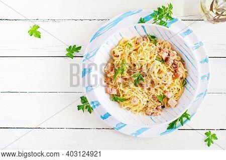 Classic Homemade Carbonara Pasta With Pancetta, Egg, Hard Parmesan Cheese And Cream Sauce. Italian C