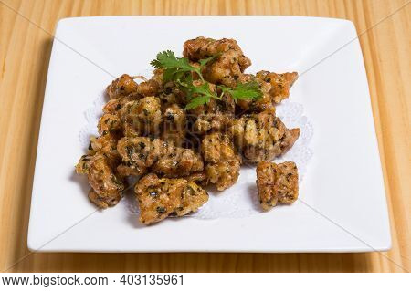 Spicy Crispy Fried Chicken Gizzards Served With Green Onions And Spicy Tomato Sauce Close-up On The