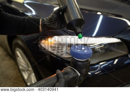 Detailing Master Applies Car Polish Paste To The Polisher. Vehicle Paintwork Polishing Concept