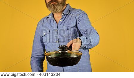 Cooking Tasty Dish. Bearded Man Hold Frying Pan. Cooking In Pot. For Preparing Food. Selective Focus
