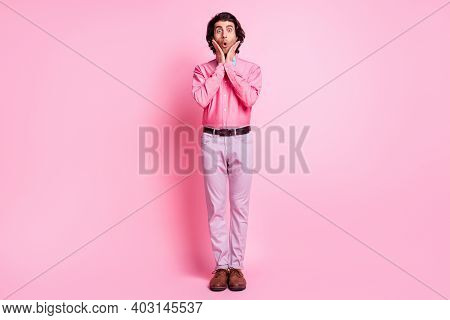 Full Size Photo Of Shocked Charming Young Man Hold Hands Cheekbones Unexpected Present Isolated On P