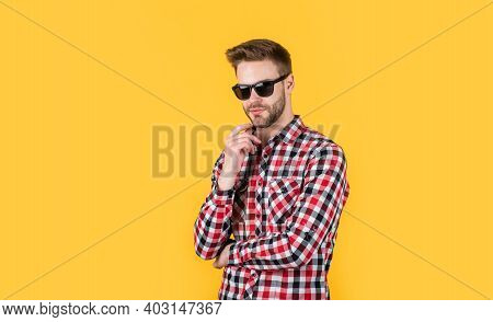 Young Handsome Guy In Checkered Shirt And Glasses. Stylish Male Wear Casual Clothes. Bearded Man Wit