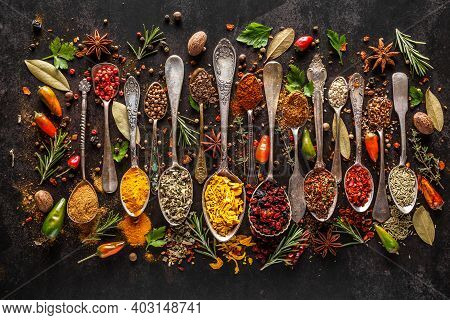 Various Spices A Vintage Spoons On Stone Table. Colorful Herbal And Spices Oriental Marketplace.top