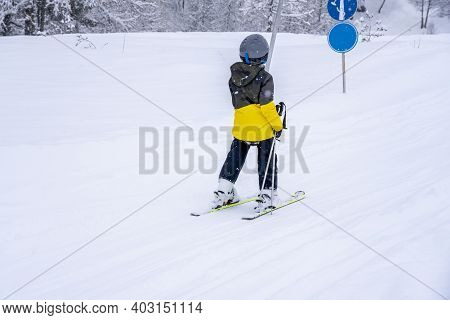 Blurred Focus Background. A Boy Lifting On The Ski Drag Lift Rope In Blue Sport Outfit On The Ski Re