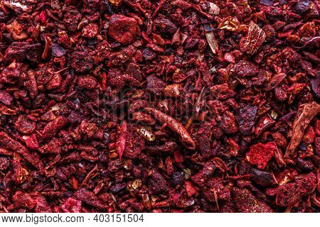 Dried Dehydrated Tomato. A Mixture Of Different Spices Close Up. Textures Of Colorful Spices And Con