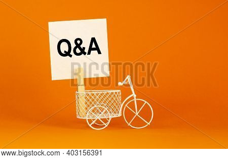 Questions And Answers Symbol. White Paper. Words 'q And A, Questions And Answers'. Miniature Bicycle