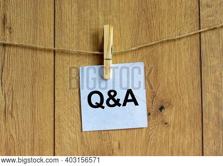 Questions And Answers Symbol. White Paper. Words 'q And A, Questions And Answers'. Beautiful Wooden