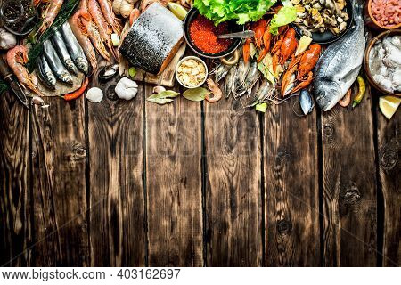 Fresh Seafood. Variety Of Seafood Shrimp, Fish, And Shellfish. On Wooden Background