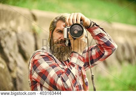 Mature Skilled Camera Man. Paparazzi Use Digital Camera. Photo Shoot Session. Handheld Shooting. Man