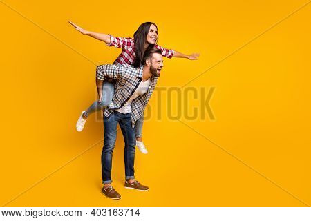 Full Length Body Size View Of Lovely Cheerful Couple Piggy Backing Having Fun Fooling Copy Space Iso