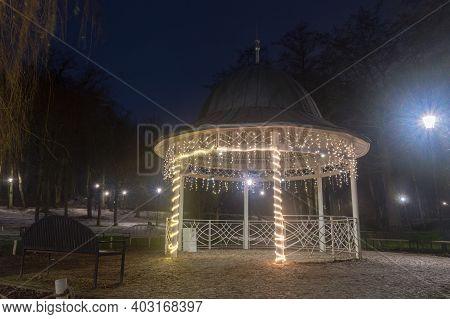 Gazebo With Christmas Illumination At Night In Orunia Park At Gdansk, Poland.