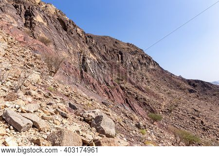 Hajar Mountains Landscape, With Limestone And Dolomite Rocks, Rocky Trail And Barren Trees, United A