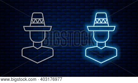 Glowing Neon Line Mexican Man Wearing Sombrero Icon Isolated On Brick Wall Background. Hispanic Man