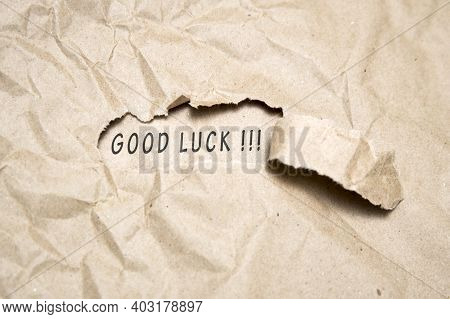 Uncovering A Good Luck. There Is A Hole In The Craft Paper, The Word Good Luck Is Printed In It.