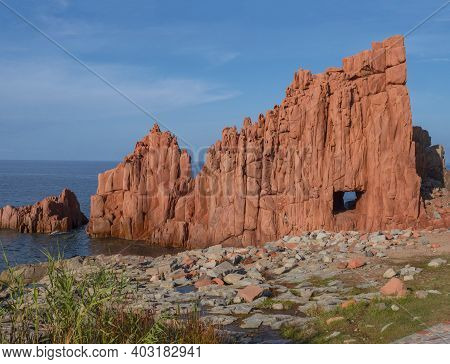 View Of Red Rocks Called Rocce Rosse At Mediterranean Sea Coastline In Arbatax Port, Penisula Of Tor