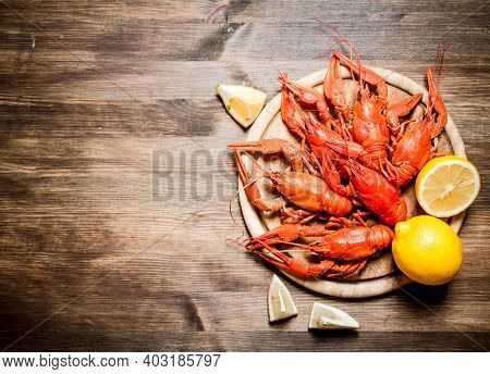 The Food Delicacies. Boiled Crawfish With Slices Of Lemon. On Wooden Background.