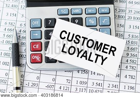 Customer Loyalty Card Text On The Card Lying On The Calculator Next To The Pen On The Table