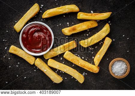 Big french fries. Fried potato chips with ketcheup. Top view.