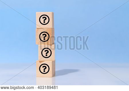 Icon Question Mark On Wooden Cube Block On Blue Background. Faq, Answer, Information, Communication