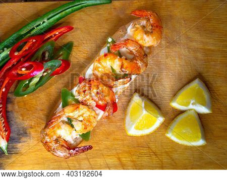 Fried Shrimp Lying On A Sandwich. Seafood Appetizer On The Table