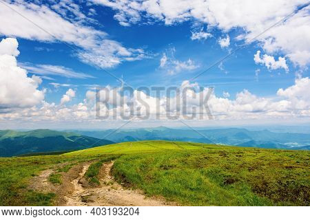 Path Through Green Grassy Mountain Meadow. Beautiful Summer Landscape. Fine Weather With Fluffy Clou