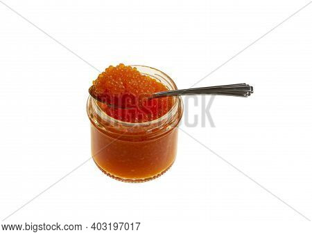 Red Caviar In A Glass Jar Isolated On White Background With Clipping Path.