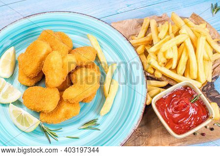Precooked Food.convenience Foods.chicken Nuggets In A Blue Plate On A Kitchen Wooden Board With Slic