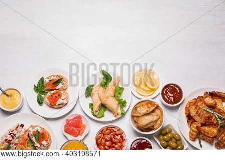 Buffet Service. Flat Lay Composition With Different Dishes On White Wooden Table, Space For Text