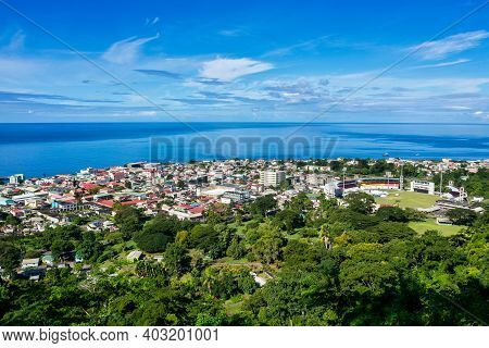 Scenic View Of Roseau Town And Sea, Dominica Island. Seen From The Small Mountain Morne Bruce. From