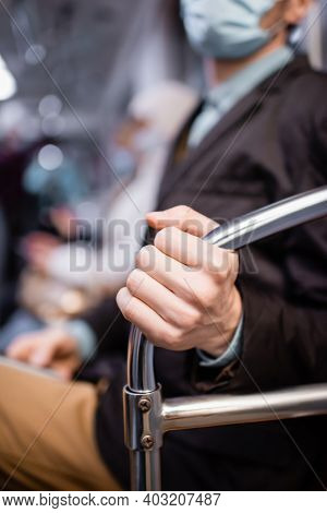 Cropped View Of Man In Medical Mask Holding Handrail In Wagon Of Metro
