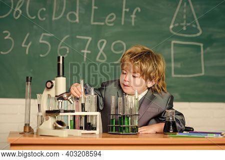 Chemistry Lab. Back To School. Little Kid Learning Chemistry In School Laboratory. Kid In Lab Coat L