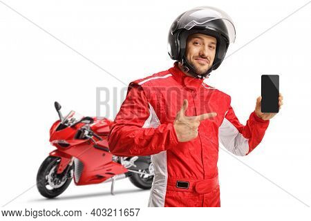 Motorbike racer in a jumpsuit showing a mobile phone isolated on white background