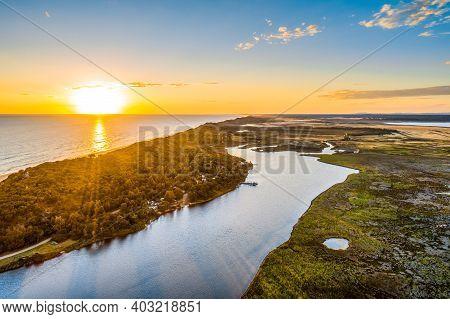 Breathtaking Sunset Over Ocean Coastline - Aerial View