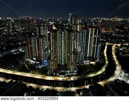 Aerial Drone View Of Modern Apartment Building In Jakarta Central Business District At Night With Ja