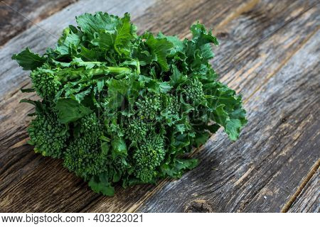 Brocoli babe bunch on rustic wooden table